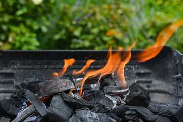 Burning charcoal on barbecue grill.