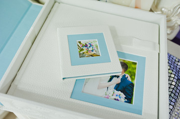 white and blue paspartu wedding photo book and album
