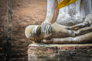 And old ruin buddha statue in Ayutthaya , Thailand