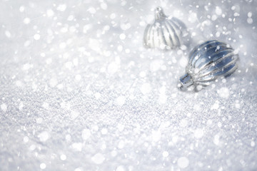 Winter Christmas snow background with baubles.
