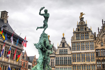 Printed roller blinds Antwerp The city hall on the central market place in Antwerp in Belgium, with many flags and the statue in front of it together with some typical buildings
