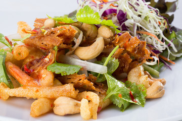 Stir-fried seafood served on white dish