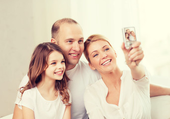 happy family with little girl making self portrait