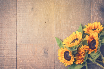 Sunflowers In Vintage Cup On Wooden Table Autumn Background