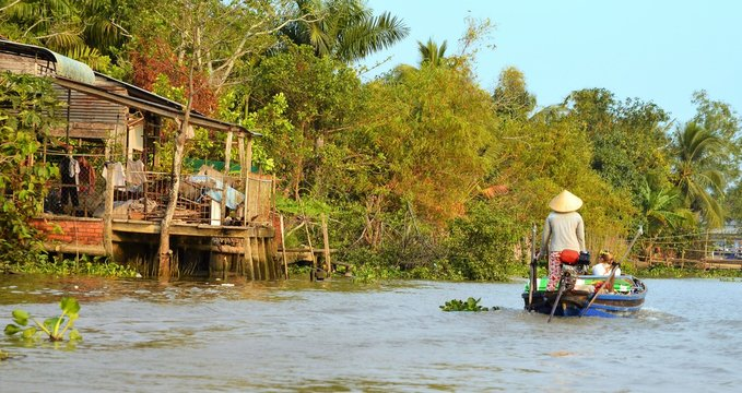 Can Tho, Vietnam - 5 March 2015: Woman moving by rowing boat, the most common transportation mean of rural people in Mekong delta Vietnam