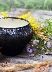Black porridge with a flowers