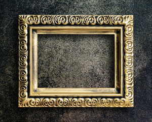 Old picture frame on grunge wall.