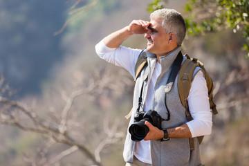 mature man hiking in mountain