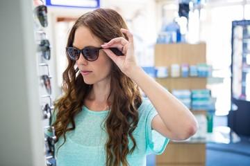 Pretty woman shopping for sunglasses
