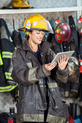 Happy Firewoman Using Digital Tablet