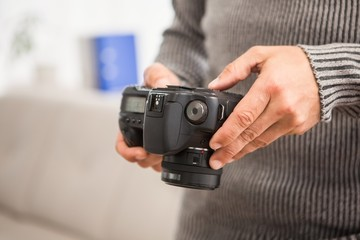 Close up view of hands holding camera