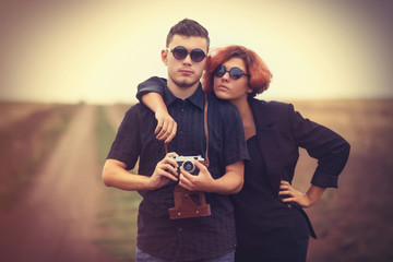 Style young couple at countryside