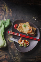 Fried spring rolls with  shrimps, bok choi, chili pepper and hot