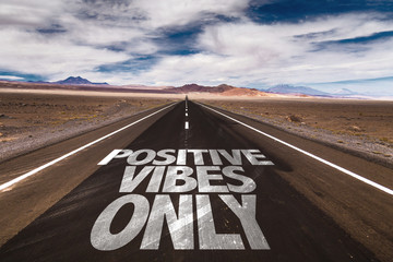 Positive Vibes Only written on desert road