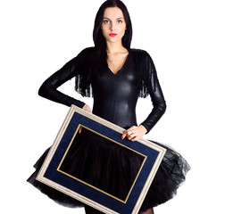 Woman wearing in black dress holding picture frame. Isolate