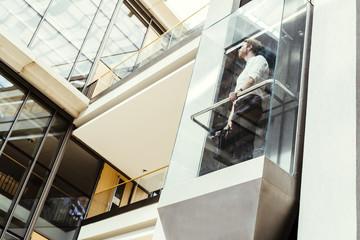 Businessman taking the elevator