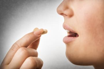 closeup taking pill