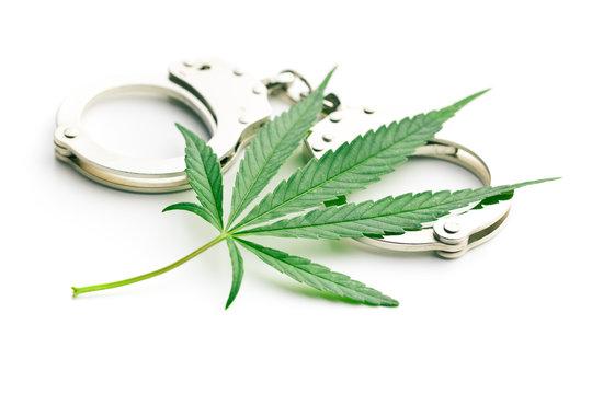 cannabis leaf and handcuffs