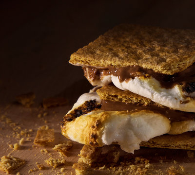 A hot, melty s'more with graham crackers toasted marshmallows and melting chocolate