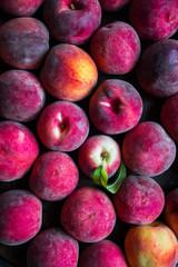 Fresh picked peaches on wooden background