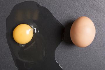 Raw egg poured onto black slate