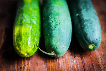 Cucumbers on wooden background