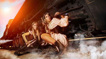 Two sexy woman in the steam-punk clothes are hiding beneath the
