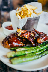 Barbecue chicken with asparagus and french fries
