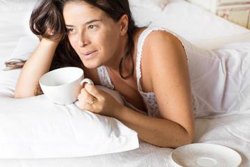 just awake girl having breakfast on the bed