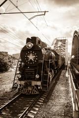 old black steam locomotive in Russia
