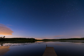 The starry night sky over a lake in Wisconsin.