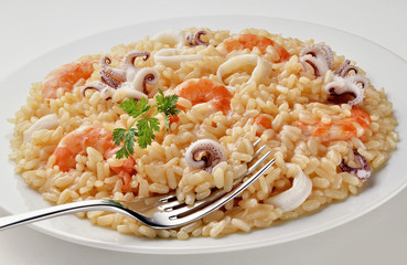 Dish of Seafood Risotto with Fork