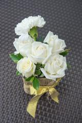 White roses in vase.