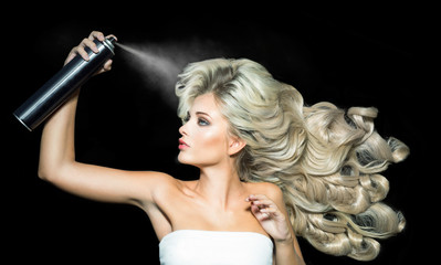 Blonde woman with a hairspray