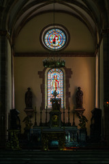 Sun light through the leaded pane in old majestic church