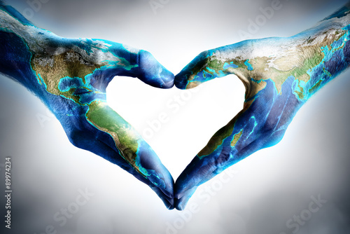 World Map On Hands.Earth S Day Celebration Hands Shaped Heart With World Map Stock