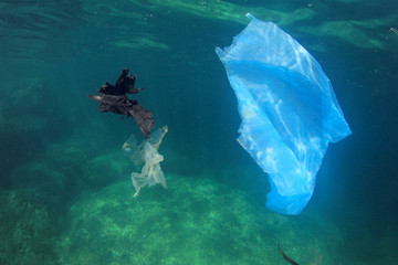 Plastic bags trash rubbish garbage pollution in ocean