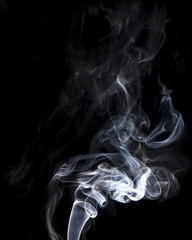 gray smoke on a black background.