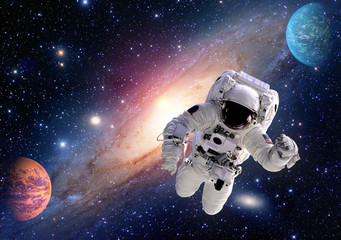 Astronaut spaceman outer space solar system people planet universe. Elements of this image furnished by NASA.