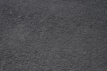 A close up view of a road surface, suitable for use as a background or texture.