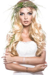 Portrait of a beautiful girl with flowers on her hair. Beauty