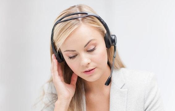 female helpline operator with laptop
