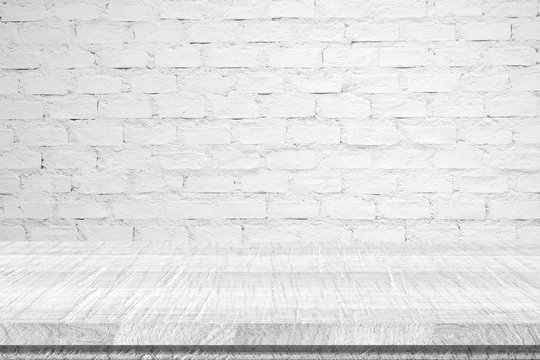 Empty white vintage wooden table over white brick wall backgroun