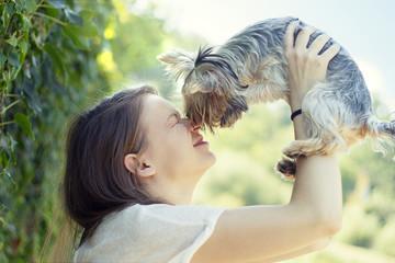 Beautiful woman to kiss the dog