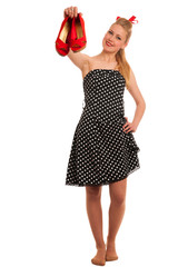 Retro style pin up girl with blonde hair in black dress wtih whi