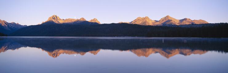 Moonset at sunrise over Redfish Lake and Sawtooth Mountains, Idaho