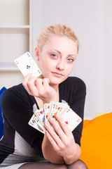 Girl shows ace card in the game