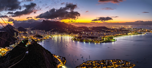 Fotomurales - Panoramic view of Rio de Janeiro by night, as viewed from Sugar Loaf peak.