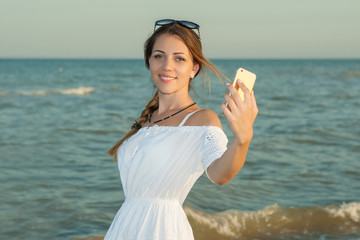 Girl taking selfie photograph using smartphone