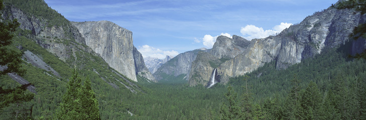 Wall Mural - This is a view of Bridal Veil Falls, Half Dome and El Capitan. It is a view of the Yosemite valley.